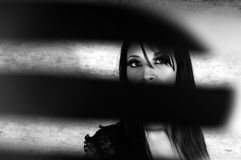 Access denied !. Artistic impression of a glamour model shot through slits. Black and white Royalty Free Stock Image