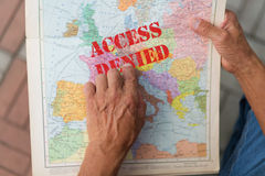 Access denied. Map of Europ in a man's hand with a sign that reads 'Access denied Stock Photo
