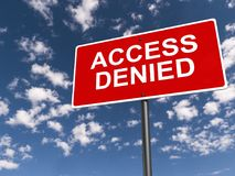 Access denied. Red highway sign with white text graphics access denied against blue skies with clouds Royalty Free Stock Image