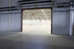 Access Door To Empty Storehouse. Access door to brightly lit and empty storehouse Stock Images