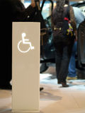 Access for Handicapped. Luminous post sing of a handicapped access in a trade fair Royalty Free Stock Photos