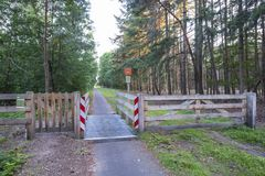 Access from a natural park with cattle grid Royalty Free Stock Images