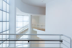 Access stair with metal handrails. Against glassed wall. High tech building Stock Images