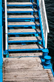 Access stairs to wooden pier Royalty Free Stock Images