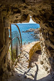 Access to the beach through the wall of the fortress in Tossa de Mar Royalty Free Stock Images