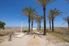 Access to Pine Beach in Grao. Access to Beach of PIne or Pinar, in Grao of Castellon, Valencia, Spain, Europe. With wooden walkway, public fountain and shower Royalty Free Stock Photos