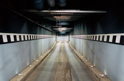 Access to an underground garage. (Long tunnel Royalty Free Stock Photos