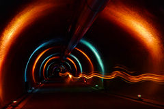 Access Tunnel - Light Show. Access tunnel to a drinking water pipeline in the city of Zurich. The photo taken during an opening ceremony with special light show Royalty Free Stock Image
