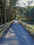 Access walkway with metal handrails. Gateway to the Regajo reservoir with metal railings royalty free stock images