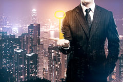 Accessibility concept. Businessman holding ornate golden key on night city background. Accessibility concept. Double exposure Royalty Free Stock Photo