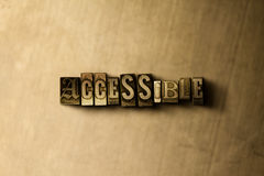 ACCESSIBLE - close-up of grungy vintage typeset word on metal backdrop Stock Images