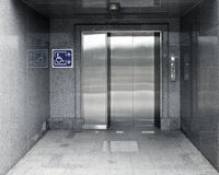 Accessible Elevator with sign and marble structure aisle Royalty Free Stock Photography