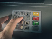 Accessing bank account. Close-up photograph of man using atm stock images