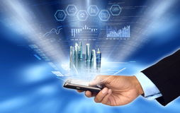 Accessing & Controlling business from smartphone. Businessman accessing and controlling his business progress and reading business report from his smart phone stock photo