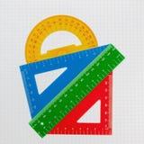 Accessoires architecte et mathématiques Sur le carnet dans une cellule Images stock