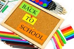 Accessoires colorés d'école de nouveau à l'école Photos stock