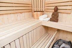 Accessoires de sauna avec Bouddha Photographie stock libre de droits