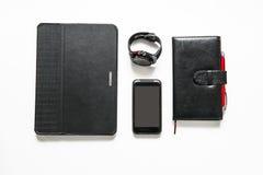 Accessoires noirs d'affaires sur la table Image stock