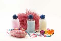 Accessoires for shower with wisp. Several coloured accessoires for shower with piece of bast Stock Photo