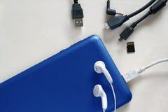 Accessori blu del telefono cellulare Fotografia Stock Libera da Diritti