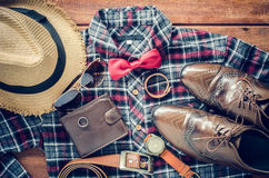 Accessories and apparel for men on a wooden floor - life style. Accessories and apparel for men on a wooden floor - life style Royalty Free Stock Images