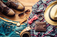 Accessories and apparel for men on a wooden floor - life style.  Stock Photos