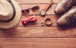 Accessories and apparel for men on a wooden floor - life style. ใ Stock Photos