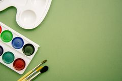 Accessories for the artist-brushes, paints, palette. copy space royalty free stock photo
