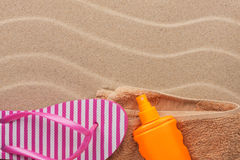 Accessories for the beach lying on the sand beach Royalty Free Stock Images