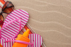 Accessories for the beach lying on the sand Stock Photo