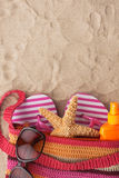 Accessories for the beach lying on the sand Stock Photography