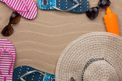 Accessories for the beach lying on the sand Royalty Free Stock Photography