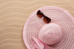 Accessories for the beach lying on the sand Royalty Free Stock Images