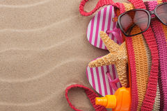 Accessories for the beach lying on the sand Royalty Free Stock Photo
