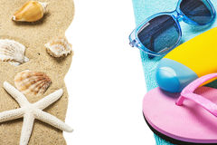 Accessories for the beach and the sea sand with seashells Stock Photos