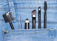 Accessories for care of the eyebrows in jeans pocket Royalty Free Stock Image