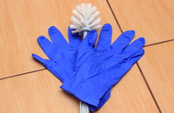 Accessories for cleaning bathroom on ceramics flooring Royalty Free Stock Images