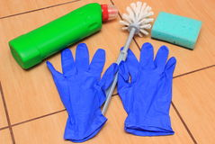 Accessories for cleaning bathroom on ceramics flooring Royalty Free Stock Photography