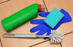 Accessories for cleaning bathroom on ceramics flooring Royalty Free Stock Photos