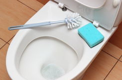 Accessories for cleaning on toilet bowl Royalty Free Stock Photos