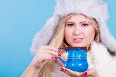 Blonde woman in winter furry hat drinking Royalty Free Stock Photo