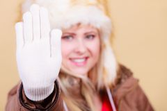 Blonde woman in winter warm furry hat Stock Image