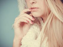 Blonde woman in winter furry hat. Accessories and clothes for cold days, fashion concept. Blonde woman in winter warm furry hat in russian style Stock Photography