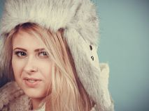Blonde woman in winter furry hat Stock Photo
