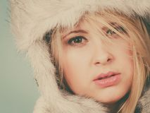 Blonde woman in winter furry hat Stock Image