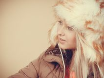 Blonde woman in winter furry hat Stock Photography
