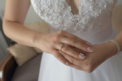 Horizontal close-up of young Caucasian female manicured hands fitting proudly her diamond engagement ring on her right hand royalty free stock images