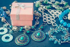 Accessories and decorations on a black background, gift box, earrings, bracelets, necklace close-up stock photography