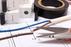 Accessories for engineer jobs lying on construction drawing Stock Images