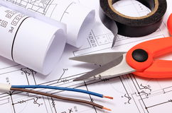 Accessories for engineer jobs and rolls of diagrams on construction drawing Stock Image